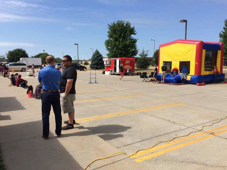 Volunteers outside enjoying our outdoor activities such as the bounce house and food vendors
